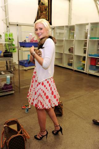 Holly Madison with her ferret Sid and newly adopted Ferret Nancy at the Animal Foundation on July 27, 2010.