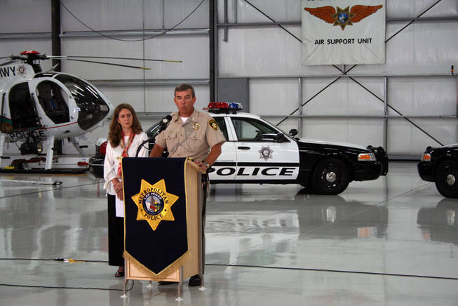 Sheriff Doug Gillespie speaks to the media about a new campaign to get officers to drive safely while Vanessa Maniago, left, vice president of strategic development for R & R Partners, which helped with the campaign, listens.