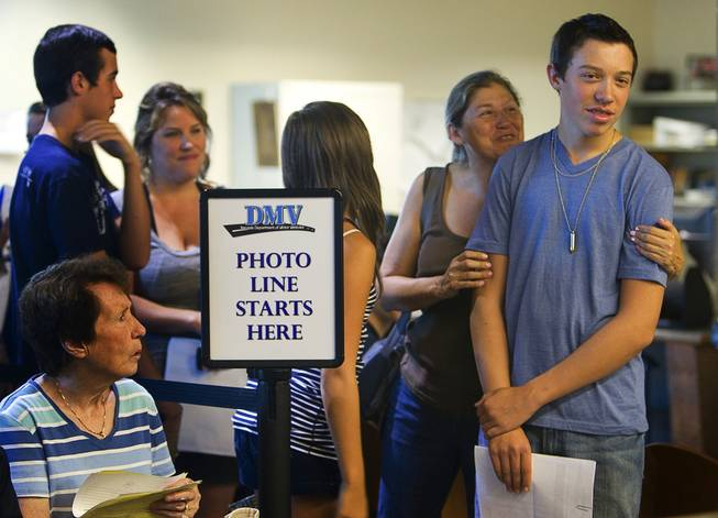 Shane Marshall, right, 16, a Foothill High School student, gets a hug from his aunt, Cris Marshall, while waiting in line at the Department of Motor Vehicles office in Henderson Monday, August 2, 2010. School officials on Wednesday will consider a policy that would prohibit students from getting driver's licenses if they cut classes.