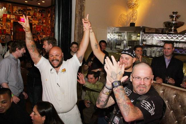 Jake Mual celebrates after winning First Food & Bar's Wing Throwdown at the Palazzo.