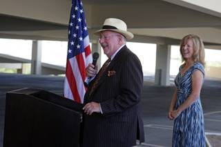 Las Vegas Mayor Oscar Goodman speaks during a groundbreaking ceremony for the U.S. 95 Corridor Improvement Project in the Santa Fe Station parking garage Tuesday, August 3, 2010. Susan Martinovich, director of the Nevada Department of Transportation, listens at right. Elements of the project include widening roads, improving interchanges and constructing sound walls.
