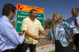 Bren Wick, project manager for Las Vegas Paving, shakes hands with Rep. Dina Titus (D-Nev.) during a news conference in Henderson Thursday, August 5, 2010. Also pictured are Rep. Xavier Becerra, left,  (D-Calif.) and Henderson Mayor Andy Hafen. The event heralded the completion of the Green Valley Parkway repaving project, which was paid for with federal stimulus money.
