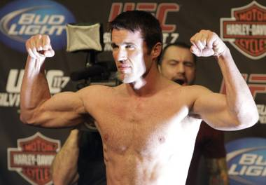 Chael Sonnen flexes after weighing in for UFC 117 in Oakland, Calif.