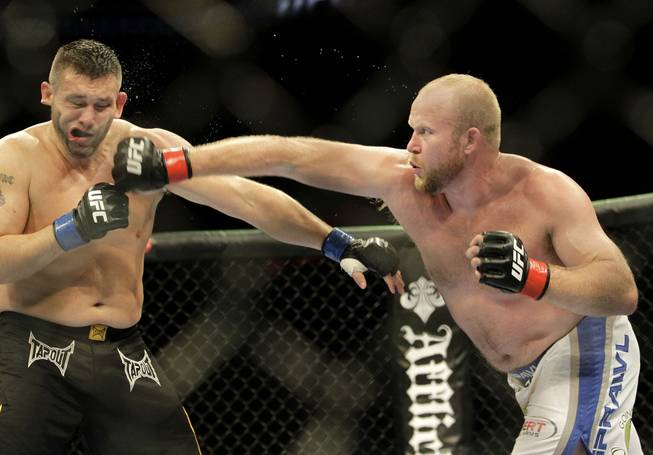 Tim Boetsch, right, punches Todd Brown at UFC 117 Saturday in Oakland, Calif. Boetsch won by unanimous decision.