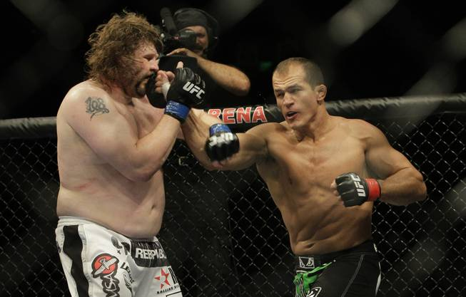 Junior Dos Santos, right, punches Roy Nelson during UFC 117 on Aug. 7, 2010 in Oakland, Calif. Dos Santos won by unanimous decision.