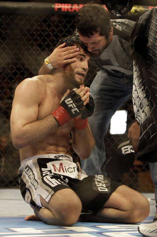 Jon Fitch, left, celebrates after beating Thiago Alves at UFC 117 in Oakland, Calif. Fitch won by unanimous decision.