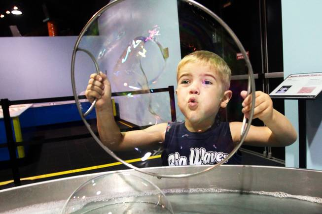 Taj Snavely plays with the bubble feature at Lied Children's Museum Wednesday as the museum announced they will be relocating to the Smith Center for the Performing Arts.