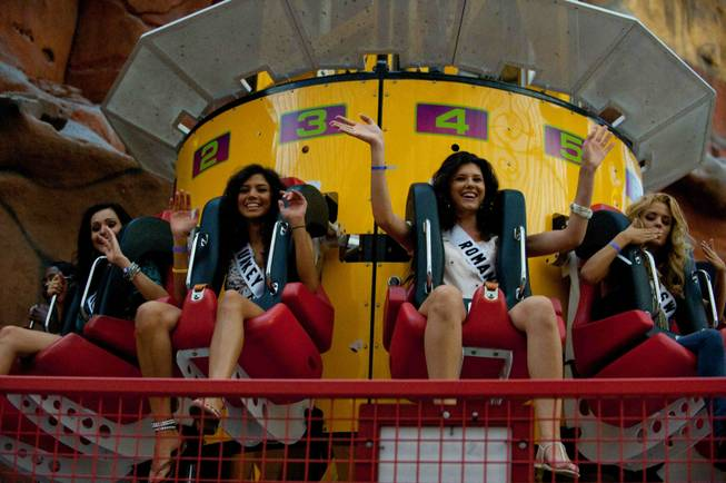 Contestants of the 2010 Miss Universe competition enjoy the rides ...