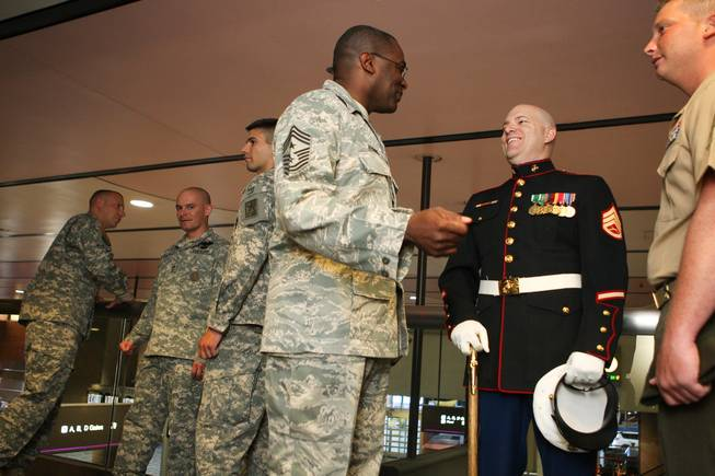 Nellis Air Force Base Installation Command Chief Sgt. Al Herring, center, visits with retired Marine Sgt. Jason Brooks and Sgt. Tyler Corbaley, right, before the groundbreaking ceremony of the new USO lounge in Terminal 1 at McCarran International Airport on Wednesday, August 18, 2010.