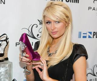 Paris Hilton unveils her Spring 2011 shoe collection at MAGIC at the Las Vegas Convention Center on Aug. 18, 2010.