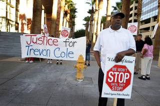 Former state assemblyman Wendell Williams protests with members of community action group A League of Action in front of the Regional Justice Center before a coroner's inquest on the death of Trevon Cole on Friday, Aug. 20, 2010.