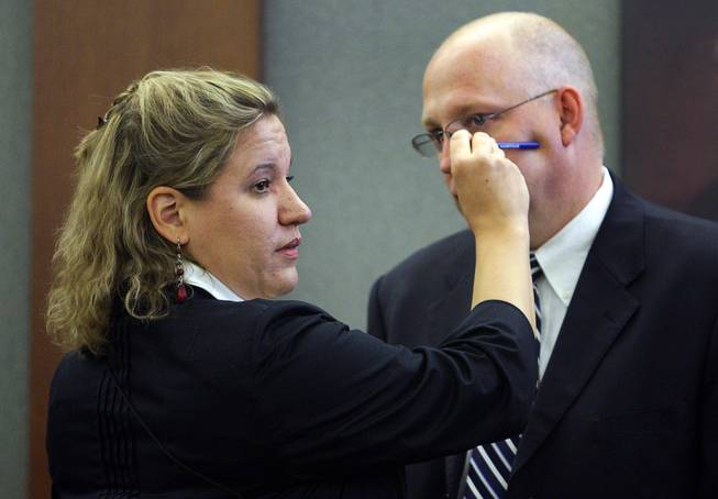 Lisa Gavin, a medical examiner with the Clark County Coroner's Office, uses Clark County Chief Deputy District Attorney Christopher Laurent  to demonstrate where a bullet struck Trevon Cole during a coroner's inquest Friday, August 20, 2010. Cole was shot and killed by Metro Police in June.