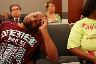 Craig Smith sinks into his chair and closes his eyes after hearing the shooting of Trevon Cole was justified during a coroner's inquest Saturday, August 21, at the Regional Justice Center.