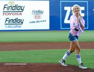 Holly Madison reacts after throwing the opening pitch at the Las Vegas 51s minor league baseball game at Cashman Field on Aug. 24, 2010.