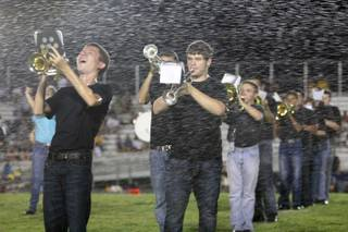 The Basic marching band got a surprise in the form of sprinklers during its halftime performance at Friday's game against Boulder City.