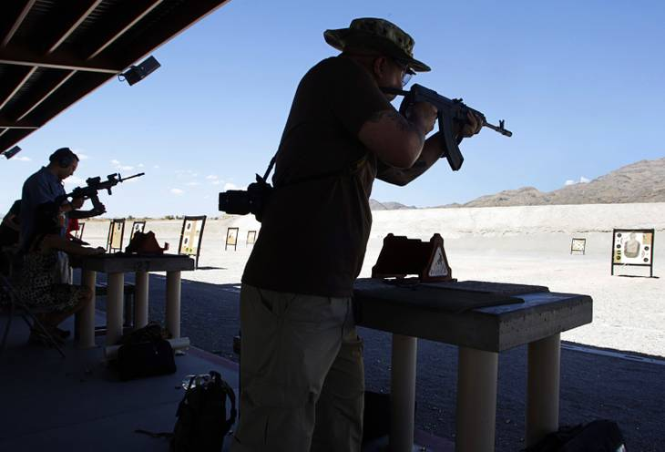 John Kong, left, and Agustin Bella fire assault rifles at the Clark County Shooting Park Friday, August 27, 2010. The $63 million shooting park gets rave reviews from shooting enthusiasts but is not making enough money to cover operational expenses.