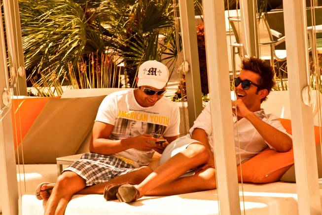 West Hollywood makes a splash in Las Vegas as The Abbey Beach debuts at Vdara Hotel and Spa.  Las Vegas Party Planner, Eduardo Cordova relaxes poolside with his boyfriend, Maurizio Decarolis, at Vdara's Abbey Beach on Sunday, August 29.  Vdaras chic Pool & Lounge is decked out with The Abbeys colorful flags and beach balls, while its 19 fully appointed cabanas are serviced by the handsome Abbey Boys.  Widely known as one of the most popular West Hollywood hot spots, The Abbey Food & Bar has partnered with Las Vegas party planner Eduardo Cordova and Vdara Hotel & Spa to host The Abbey Beach.  The Abbey Beach at Vdara Pool & Lounge occurs every Sunday now through September 26, noon  6 p.m offering a taste of The Abbeys signature LGBT party in the heart of CityCenter.