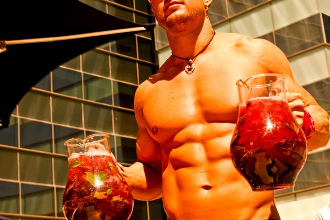 West Hollywood makes a splash in Las Vegas as The Abbey Beach debuts at Vdara Hotel and Spa.  Jeffrey Art, one of the handsome Abbey Boys, serves pitchers of cocktails poolside at Vdara's Abbey Beach on Sunday, August 29.  Vdaras chic Pool & Lounge is decked out with The Abbeys colorful flags and beach balls, while its 19 fully appointed cabanas are serviced by the handsome Abbey Boys.  Widely known as one of the most popular West Hollywood hot spots, The Abbey Food & Bar has partnered with Las Vegas party planner Eduardo Cordova and Vdara Hotel & Spa to host The Abbey Beach.  The Abbey Beach at Vdara Pool & Lounge occurs every Sunday now through September 26, noon  6 p.m offering a taste of The Abbeys signature LGBT party in the heart of CityCenter.