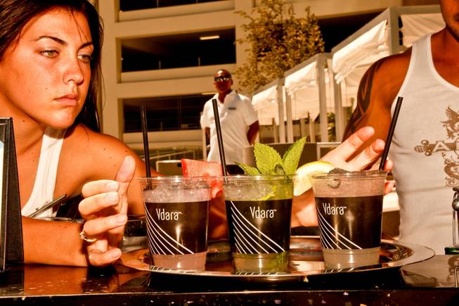 West Hollywood makes a splash in Las Vegas as The Abbey Beach debuts at Vdara Hotel and Spa.  Ashley, one of the bartenders, serves Abbey's signature cocktails, The Watermelon Martini, The Abbey Mojito, and Abbeys Old Fashion Lemonade, at Vdara's Abbey Beach on Sunday, August 29.  Vdaras chic Pool & Lounge is decked out with The Abbeys colorful flags and beach balls, while its 19 fully appointed cabanas are serviced by the handsome Abbey Boys.  Widely known as one of the most popular West Hollywood hot spots, The Abbey Food & Bar has partnered with Las Vegas party planner Eduardo Cordova and Vdara Hotel & Spa to host The Abbey Beach.  The Abbey Beach at Vdara Pool & Lounge occurs every Sunday now through September 26, noon  6 p.m offering a taste of The Abbeys signature LGBT party in the heart of CityCenter.