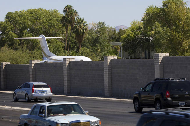 The tail of a jet plane can be seen Tuesday over a wall on the property of entertainer Wayne Newton. Newton, who lives at Pecos and Sunset roads, may create an attraction on the property that could include a museum and a theater where he'll perform after people complete a tour.