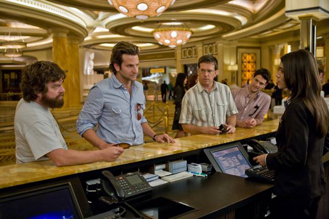 """The Hangover"" actors, from left, Zach Galifianakis, Bradley Cooper, Ed Helms and Justin Bartha, appear in a scene at Caesars Palace's reception area."