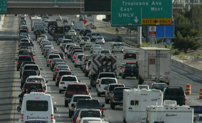Motorists navigate rush hour traffic on Interstate 15 near the Strip.