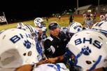 Basic High School assistant football coach Dan Cahill instructs players in this 2010 file photo.
