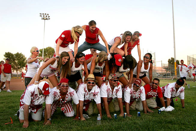 Wisconsin fans make a human pyramid at a tailgate party before their season opening game against UNLV on Saturday, September 9, 2010 at Sam Boyd Stadium.
