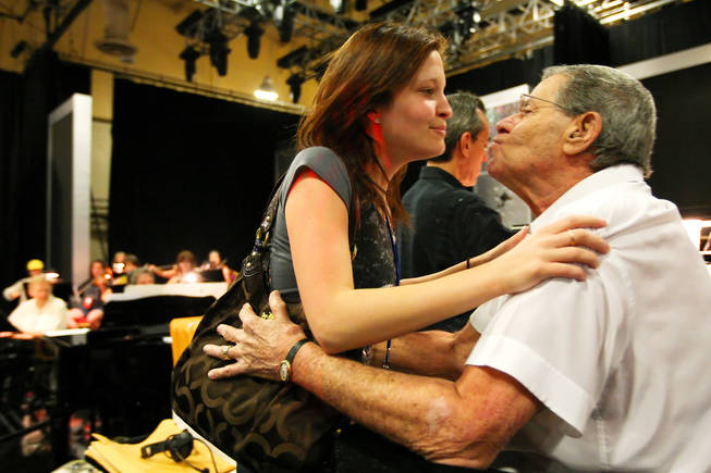 Danielle Lewis, 18, gives her dad, Jerry Lewis, a kiss during rehearsal for the 45th Annual Jerry Lewis MDA Labor Day Telethon Sunday night at the South Point.  This year's telethon hopes to raise $70 million to surpass 2009's earnings of $60 million in the fight against muscular dystrophy.