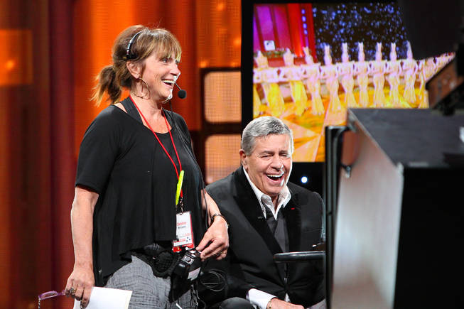 Jerry Lewis and stage manager Debbie Williams laugh with each other during the 45th Annual Jerry Lewis MDA Labor Day Telethon on Sunday night at South Point.