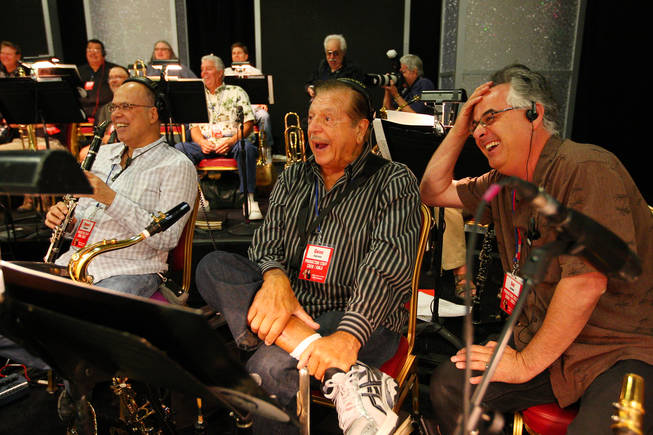 Members of Jerry Lewis' band, from right, Sal Lozano, Gene Cipriano and Bob Sheppard, crack up laughing at Jerry Lewis' jokes during rehearsal for the 45th Annual Jerry Lewis MDA Labor Day Telethon Sunday night at the South Point.  This year's telethon hopes to raise $70 million to surpass 2009's earnings of $60 million in the fight against muscular dystrophy.