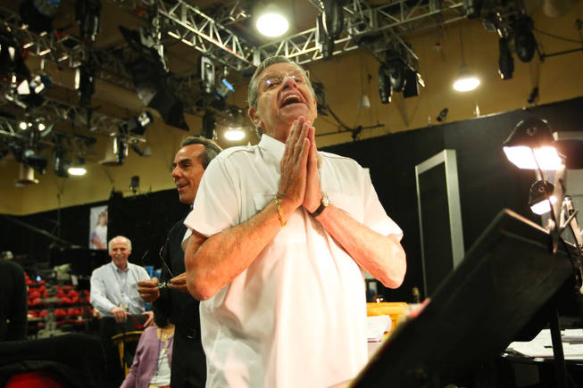 Jerry Lewis begs his band to play a humorous melody for him comprised of random notes during rehearsal for the 45th Annual Jerry Lewis MDA Labor Day Telethon Sunday night at the South Point.  This year's telethon hopes to raise $70 million to surpass 2009's earnings of $60 million in the fight against muscular dystrophy.