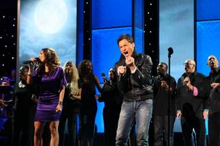 Opera singer Niko performs with a choir during the 45th Annual Jerry Lewis MDA Labor Day Telethon Sunday night at the South Point.  This year's telethon hopes to raise $70 million to surpass 2009's earnings of $60 million in the fight against muscular dystrophy.