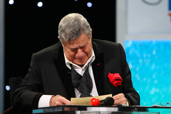 Jerry Lewis is overcome with joyful tears after receiving a multimillion-dollar check from the International Association of Firefighters during the final hour of the 45th Annual Jerry Lewis MDA Labor Day Telethon at South Point.