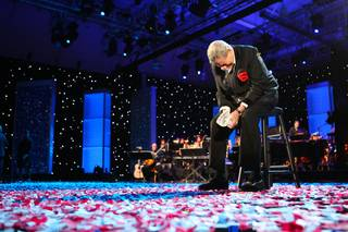 As the celebration confetti lies on the floor, Jerry Lewis breaks down in joyous tears after hearing the final tally of $58,919,838 Monday afternoon in the final hour of the 45th Annual Jerry Lewis MDA Labor Day Telethon.