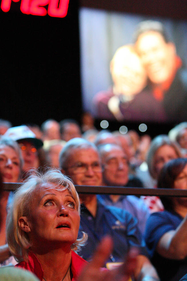 An audience member gazes upward to the tote board to watch the final tally of $58,919,838 come in during the final hour of the 45th Annual Jerry Lewis MDA Labor Day Telethon at South Point.