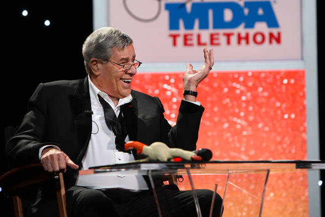 With a rubber chicken laying next to him on the table, Jerry Lewis continues to crack jokes Monday afternoon during the 20th hour of the 45th Annual Jerry Lewis MDA Labor Day Telethon at South Point.