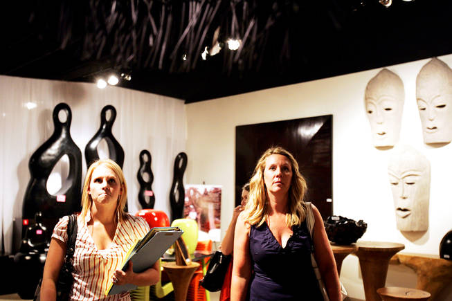 Breanne Antos, left, and Tina Enard of Reno-based Urban Design Studio check out home accessories at a store in World Market Center September 8, 2010.