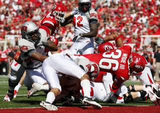 Utah runningback Eddie Wide (36) gets past UNLV defenders for a touchdown in the second quarter of an NCAA college football game at Rice-Eccles Stadium, Saturday, Sept. 11, 2010, in Salt Lake City, Utah.