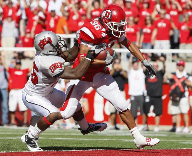 UNLV safety Mike Grant (25) is unable to stop Utah running back Eddie Wide (36) as he scores a touchdown in the 4th quarter of an NCAA college football game at Rice-Eccles Stadium, Saturday, Sept. 11, 2010, in Salt Lake City, Utah.  Utah defeated UNLV 38-10.