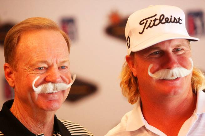Charley Hoffman, part of UNLV golf's 1998 national championship team and a top PGA Tour player, poses for a photo with Rebel coach Dwaine Knight during a media for the 2010 Justin Timberlake Shriners Hospitals for Children Open.
