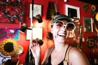 Laura Marie of Las Vegas tries on sunglasses at Retro Vegas, which is located in the Arts District on South Main Street near Charleston Boulevard in downtown Las Vegas Thursday, September 16, 2010.