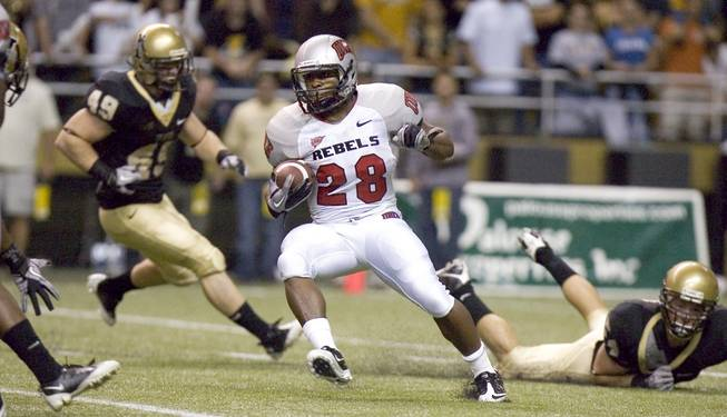 UNLV's Bradley Randle (28) cuts upfield during a second quarter kick return against Idaho on Saturday at the Kibbie Dome in Moscow, Idaho. The Rebels fell to the Vandals, 30-7, dropping to 0-3 on the season.