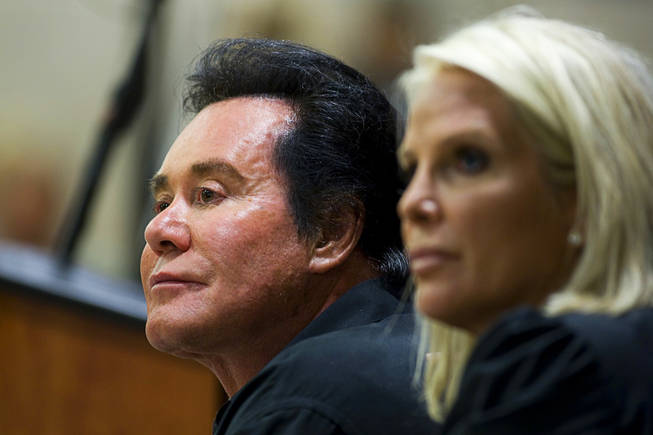 Entertainer Wayne Newton and his wife Kathleen listen to homeowner's concerns during a meeting at the La Quinta Inn Monday, September 20, 2010. Newton hosted the neighborhood meeting to discuss development plans that would include tours on his property.