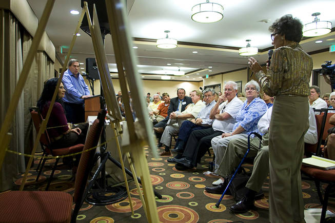 M.J. Harvey, chair of the Paradise Town Board, asks a question during a meeting at the La Quinta Inn Monday, September 20, 2010. Wayne Newton's representative Jay Brown listens at left. Newton hosted the neighborhood meeting to discuss development plans that would include tours on his property.