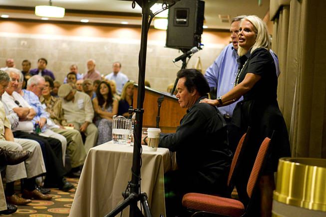 Kathleen Newton gives a back rub to her husband during a meeting at the La Quinta Inn Monday, September 20, 2010. Entertainer Wayne Newton hosted the neighborhood meeting to discuss development plans that would include tours on his property.