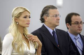 Paris Hilton stands in front of the judge with attorneys David Chesnoff, center, and Richard Schonfeld at the Regional Justice Center in Las Vegas September 20, 2010. Hilton pleaded guilty to charges stemming from her arrest for cocaine possession at the Wynn Las Vegas.
