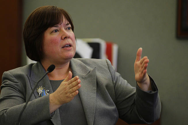 Dr. Alane Olson, a medical examiner for the coroner's office, testifies about gunshot wounds during a coroner's inquest at the Regional Justice Center Wednesday, September 22, 2010.