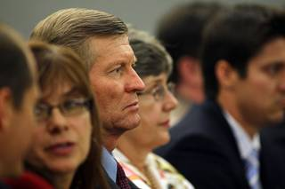 Bill Scott, Erik Scott's father, listens to testimony during a coroner's inquest at the Regional Justice Center Wednesday, September 22, 2010.