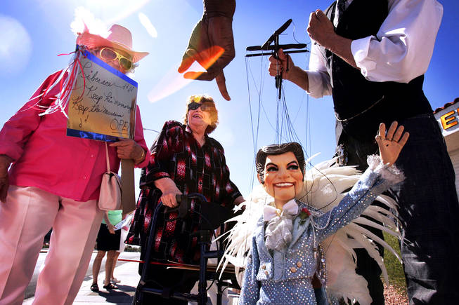 Barbara Winters, from left, Esther Lynn and Joseph Gabriel (with the LIberace puppet) protest the closing of the Liberace Museum in front of the museum in Las Vegas Wednesday, September 22, 2010.